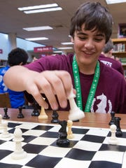 Ransom Middle School student Connor Thompson takes an opponents chess piece during a recent practice. The Ransom Chess Club recently took part in a national chess competition and finished in the top 15.