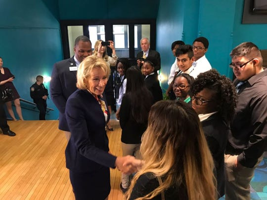 U.S. Secretary of Education Betsy DeVos greets students during a Tuesday morning visit to Providence Cristo Rey High School.