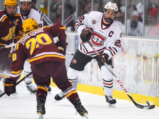 St. Cloud State's Jimmy Schuldt makes a pass against
