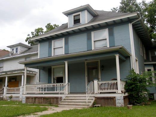 A developer is seeking approval from the city's Landmarks Board to renovate houses at 1040 and 1046 E. Walnut Street and construct a two-story duplex behind them.