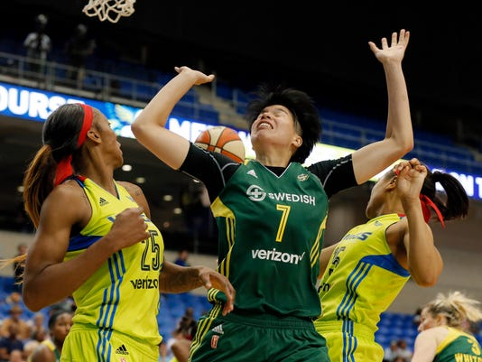 Seattle Storm forward Ramu Tokashiki (7) loses control of a defensive rebound against Dallas Wings' Glory Johnson (25) and Allisha Gray, right, in the second half of a WNBA basketball game, Friday, Aug. 4, 2017, in Arlington, Texas. (AP Photo/Tony Gutierrez)