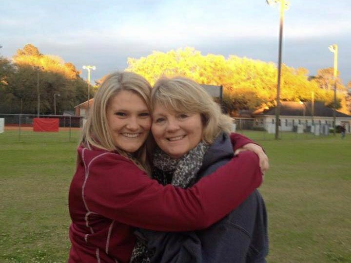Susie Morris, right, with daughter Spenser, who coaches the Munroe volleyball team.