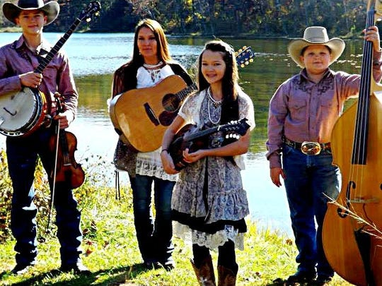 The Baker Family bluegrass band will be playing Saturday in downtown Yellville for Music on the Square.