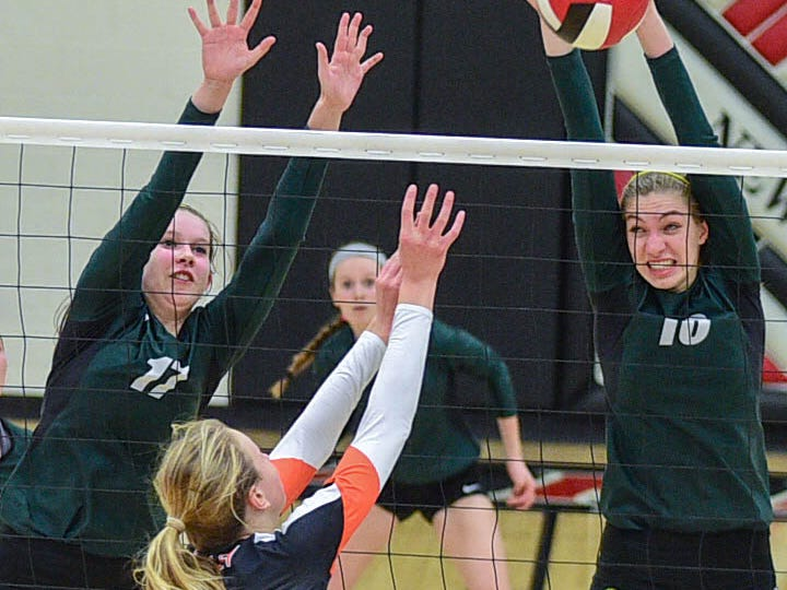 Iowa City West's Ali Tauchen (10) blocks a volley at the Class 5A-Region 5 regional finals held at Newton High School on Tuesday, Nov. 4, 2014.