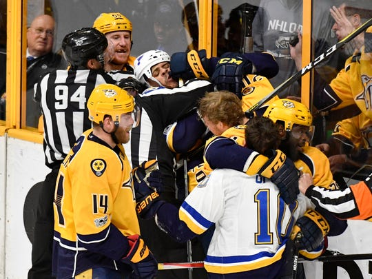 The Predators and Blues tussle during the second period in game 4 of the second round NHL Stanley Cup Playoffs at the Bridgestone Arena Tuesday, May 2, 2017, in Nashville, Tenn.