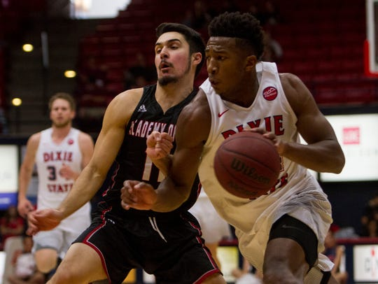 Dixie State's Trevor Hill dribbles past an Academy of Art defender during the Trailblazers' Dec. 2 game at the Burns Arena.