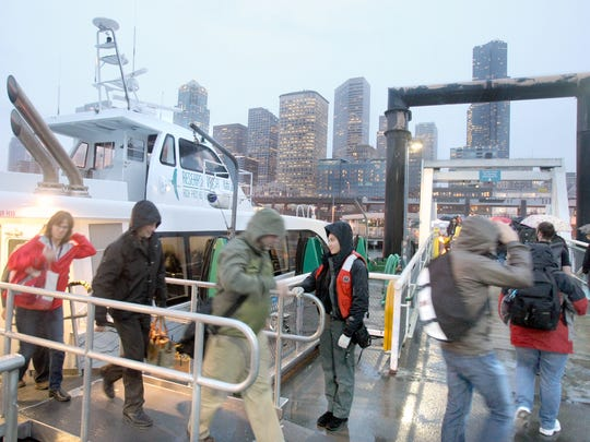 Passengers disembark the fast ferry Rich Passage 1 in Seattle.