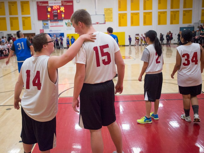 Cory Breslin of the Lobos shares a moment with teammate