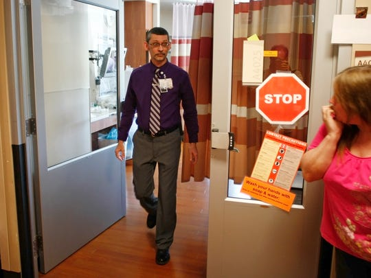 Salem Hospital Chaplain Ken Morse walks out of a patient's room in the intensive care unit on Thursday. Morse and his fellow chaplains provide comfort to patients as well as their families in times of great stress.