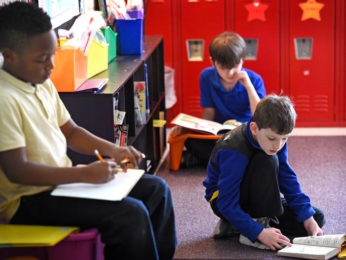 Third graders Derrick Roberson, Jeremiah Silvas and