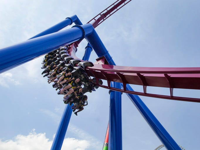 Inverted coasters feature trains that hang suspended from the track above and leave passengers' legs dangling.