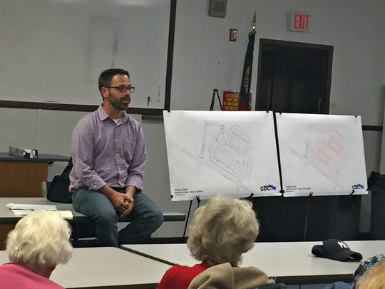 Chris Day, a senior project manager at Civil Design Concepts, who is working with developer Rusty Pulliam, discusses plans Wednesday for a 272-unit apartment complex at 60 Mills Gap Road in South Asheville.