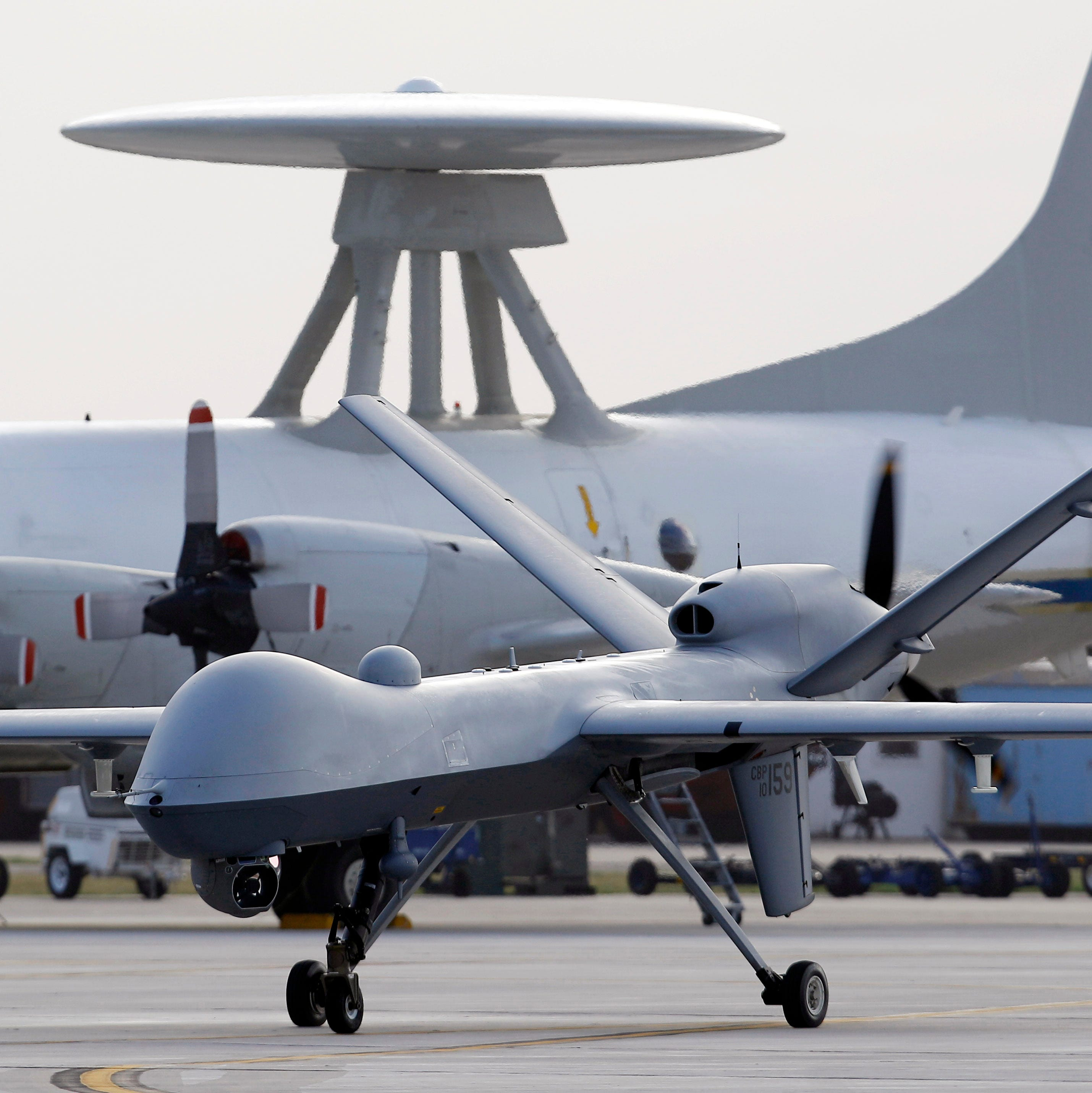 In this Nov. 8, 2011 photo, a Predator B unmanned aircraft taxis at the Naval Air Station in Corpus Christi, Texas. Two U.S. drone strikes killed a total of nine suspected al-Qaida militants Thursday.