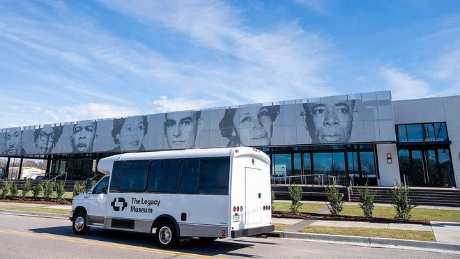 A shuttle drives by the EJI Legacy Pavilion, featuring the faces of civil rights warriors, in Montgomery, Ala, on Friday.