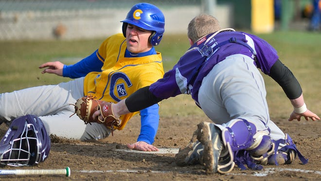 St. Cloud Cathedral's Steven Neutzling narrowly avoids the tag at home from Albany catcher Carter Holthaus in the third inning Tuesday, April 15 in Avon to score their third run. Despite his effort, Albany won 4-3.