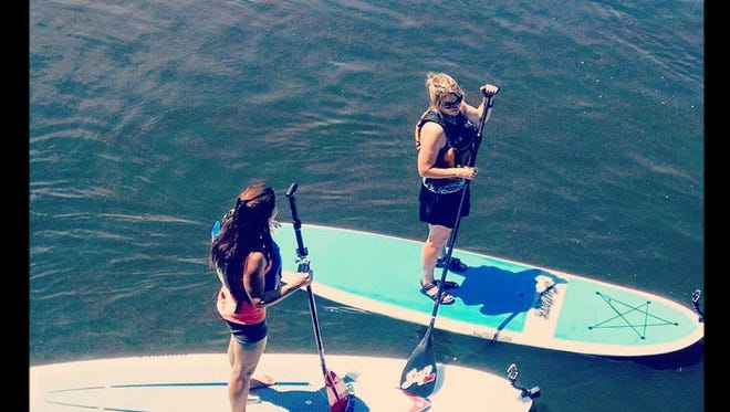 Take a Standup Paddleboard History Tour in Wisconsin Rapids.