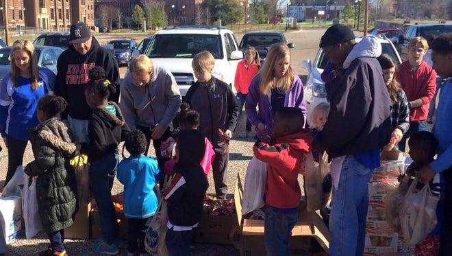 Citizens line up to receive food from local group.