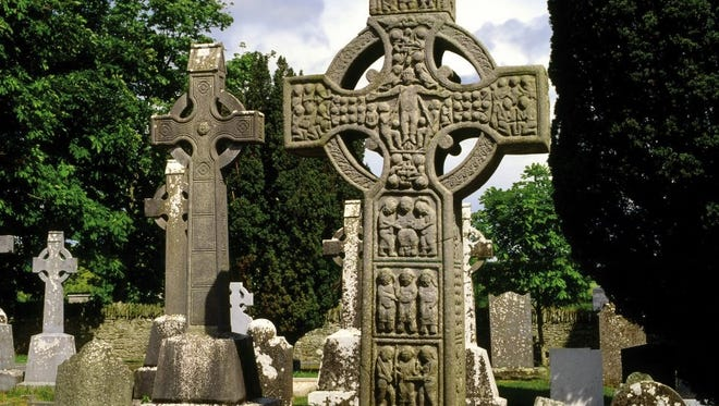 Celtic Cross at Monasterboice holy site, County Louth, Ireland. Patrick modified the cross with a sun to make it more palatable to the Irish as they converted to Christianity. Beth Dippel photo