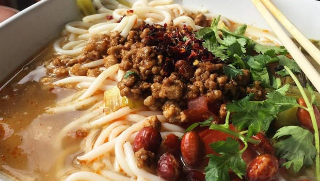 Ming's Noodles serves up hot and sour soup with ground pork.