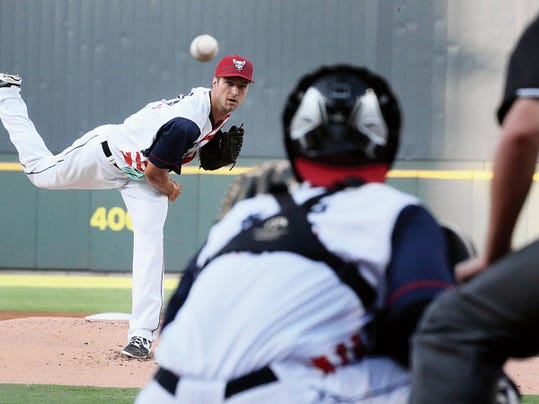Rudy Gutierrez—El Paso Times El Paso Chihuahuas right hander Colin Rea fires away against the Fresno Grizzlies Friday night at Southwest University Park. Rea was replaced on the mound by left hander Chris Rearick after a series of big hits by the Grizzlies in the first few innings of the game.