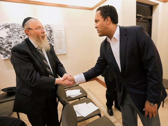 MARK LAMBIE—EL PASO TIMES  U.S. Rep. Will Hurd, R-Texas, talks with El Paso Rabbi Yisroel Greenberg after speaking at the Jewish Federation of El Paso's annual meeting Sunday.