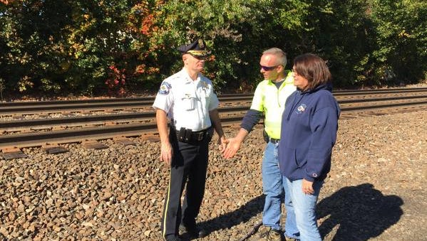"""Suffern plans to build a crossing for emergency vehicles across NJ Transit's railroad track to connect to the West Ward neighborhood. Pictured are Suffern Police Chief Clarke Osborn, DPW supervisor Joe Hunt and Mayor Patricia """"Trish"""" Abato."""