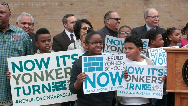 Yonkers students attend a rally May 4 at the Martin Luther King Jr. Academy, calling for the state to rebuild the city's crumbling schools.