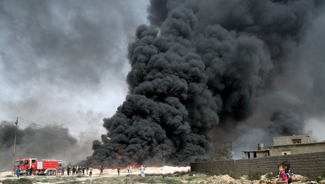 Oil wells on the edge of Qayyara, Iraq, burn on Aug. 31, 2016, days after the key town south of Mosul was retaken from the Islamic State by Iraqi ground forces backed by U.S.-led coalition airpower.