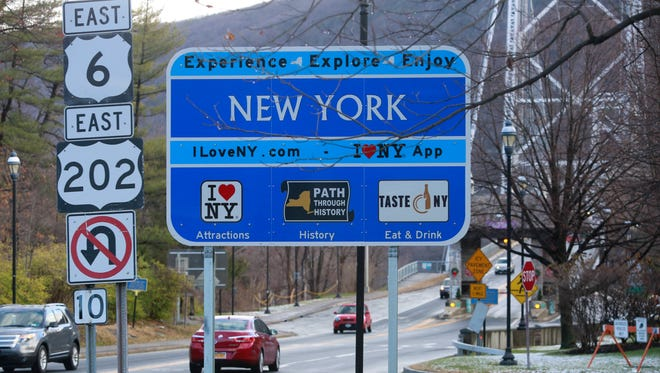 Signs put on side of the road at the foot of the Bear Mountain Bridge on the Bear Mountain side, Dec. 5, 2016.