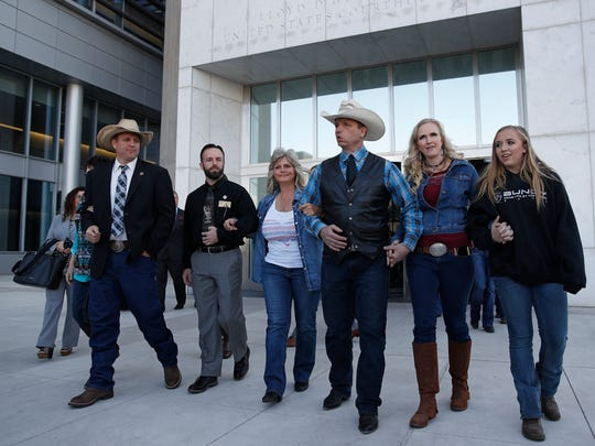 """(From left) Ammon Bundy; Ryan Payne; Jeanette Finicum, widow of Robert """"LaVoy"""" Finicum; Ryan Bundy; Angela Bundy, wife of Ryan Bundy; and their daughter, Jamie Bundy, walk out of a federal courthouse on Dec. 20, 2017, in Las Vegas."""