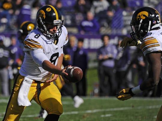Iowa quarterback Tyler Wiegers (8) bolstered Eastern
