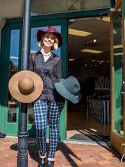 Skye Gifford models hats at Maven Womenswear in River Ranch in Lafayette, La., Tuesday, Nov. 10, 2015.