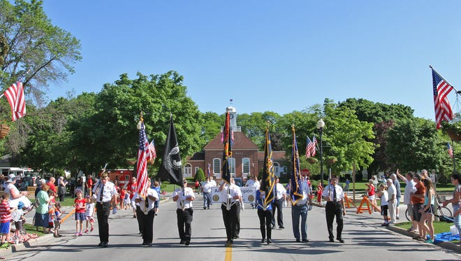 Parade fans in Greendale won't be able to stake out a good seat days in advance anymore, with the village enacting a new parade ordinance. This 2016 file photo shows a Greendale veterans' color guard leading the Greendale Memorial Day parade on Broad Street.