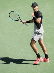 Borna Coric of Croatia celebrates winning a game against South African Kevin Anderson on Stadium One during their quarterfinal match at the 2018 BNP Paribas Open at Indian Wells Tennis Garden on March 15, 2018. Comic won the match 2-6, 6-4, 6-4, 7-6 (3).