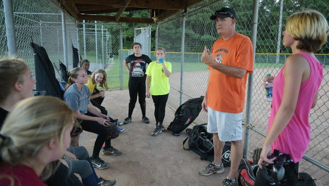 Fairview, Tenn. U12 Girls Softball team coach Paul Stacey talks with players during practice on Wednesday July 27, 2016. The team is competing in the  Dixie Youth Softball World Series in Myrtle Beach, South Carolina.