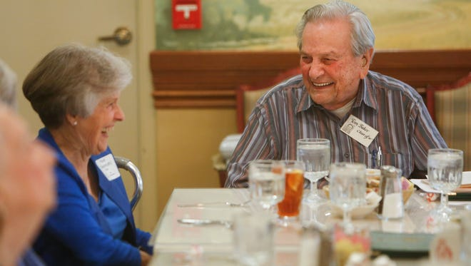 Tom Baker laughs with Hazel Riker at the 75-year reunion of the Central High School Class of 1941.