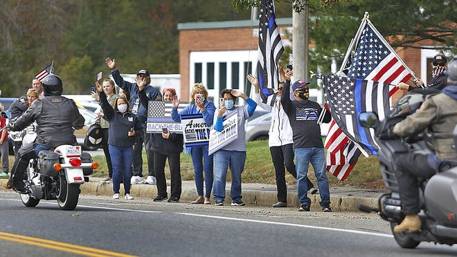 Dozens of supporters gather outside the Weymouth police station. Hundreds of motorcyclists gathered in Whitman for an America Backs the Blue rolling motorcycle rally on the South Shore, ending in Weymouth, on Sunday, Sept. 20, 2020.