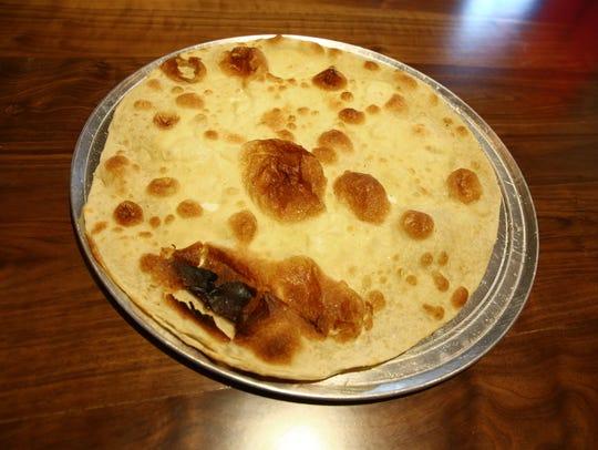 Focaccia di Recco with stracchino cheese and sea salt