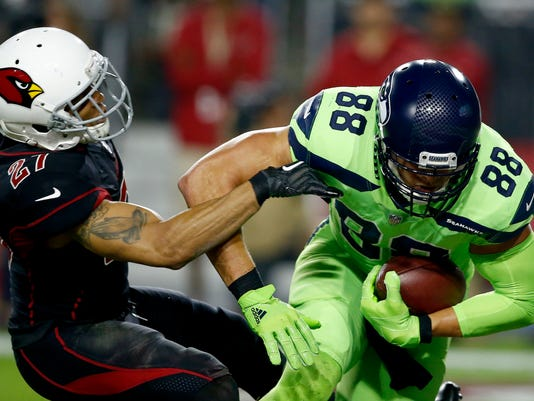 Seattle Seahawks tight end Jimmy Graham (88) catches a touchdown pass as Arizona Cardinals strong safety Tyvon Branch (27) defends during the first half of an NFL football game, Thursday, Nov. 9, 2017, in Glendale, Ariz. (AP Photo/Ross D. Franklin)