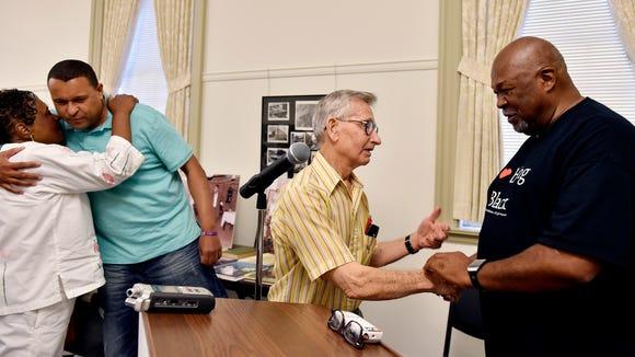John Seville, of York Township, center, greets Jeff
