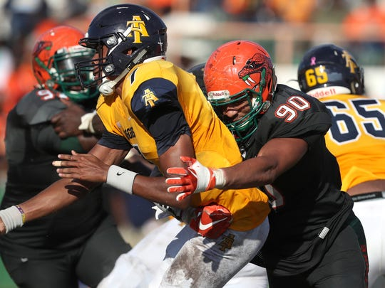 FAMU's Elijah Price hits N.C. A&T's Lamar Raynard just