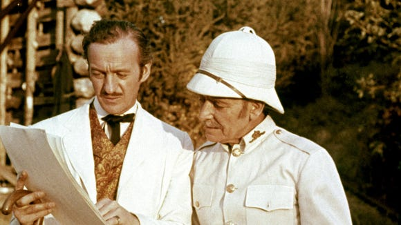 "Phileas Fogg (David Niven, left, with Robert Newton) circumnavigates the globe on a bet in ""Around the World in 80 Days."""