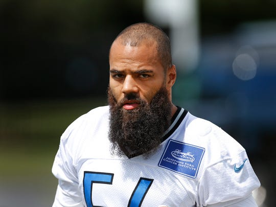 Detroit Lions line backer DeAndre Levy walks to practice during NFL football training camp in Allen Park, Mich., Tuesday, Aug. 4, 2015.