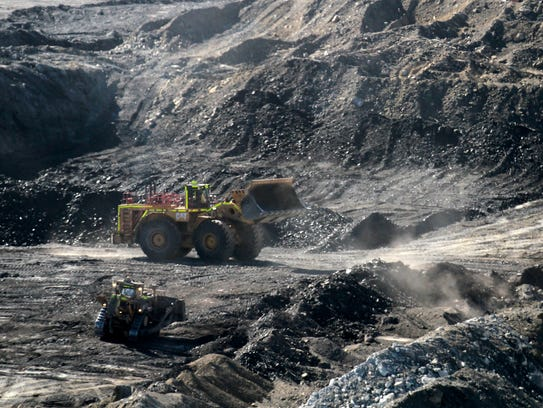 A bulldozer shovels coal in March at the Dixon Pit