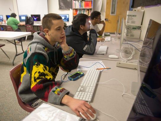 Seniors Jacob Sharp, left, Augustin Blackwater and Jenecio Avalos work in the computer lab Jan. 17, 2017, at Rocinante High School in Farmington.