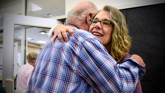 April Myers hugs friends and family members during a benefit event for her  Sunday at the Sauk Rapids Government Center Community Room. Myers was recently named the Sauk Rapids Citizen of the Year. She was diagnosed with a brain tumor in early 2015.