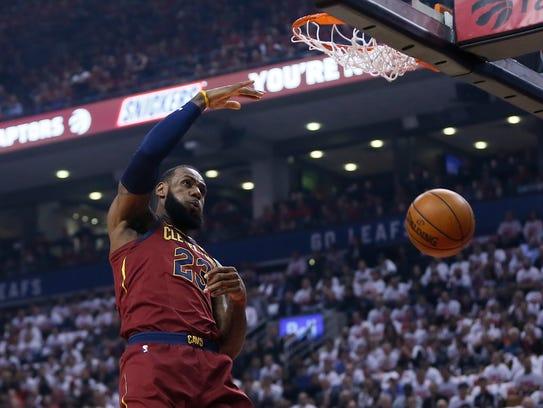 Cleveland Cavaliers forward LeBron James (23) makes