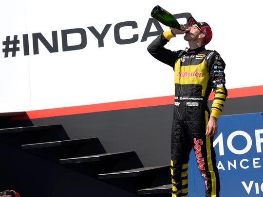 Sebastien Bourdais (18) celebrates after winning the