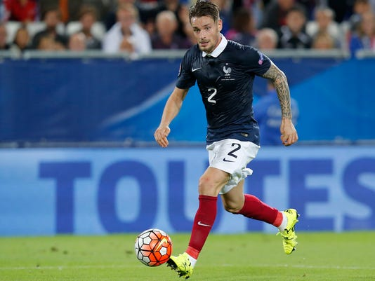 FILE - In this Sept.7, 2015 file photo, France's Mathieu Debuchy, controls the ball during a friendly soccer match France against Serbia in Bordeaux, western France. In many ways, Saint-Etienne's actual good run of form is down to the resurgence of Mathieu Debuchy, who has made an impressive return to the French league. With less than four months before the World Cup in Russia, the former Arsenal player has a decent chance to earn a France recall. (AP Photo/Michel Euler, File)