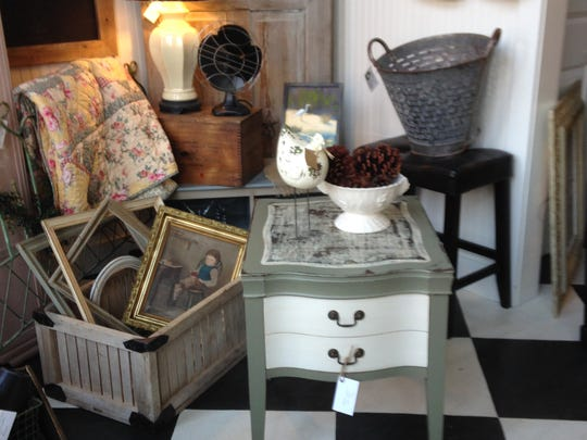 A side table is painted and restored by the Cornwell team.